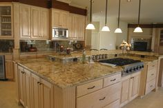 Kitchen Light Brown Sandstone Countertop Above White Wooden ...