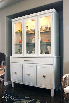 Legs added to a traditional cherry cabinet, then painted white. Completely transformed!