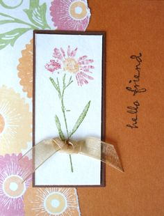 I liked the colors of the flowers in the paper, so I used the same colors in my stamped flower; then added a bow and the sentiment...