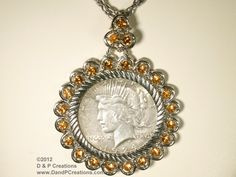 U. S. 1924 Peace Silver Dollar in vintage Topaz Color Rhinestone-studded Bezel with Necklace Chain c. 1950.  Available from D & P Creations on TrEmbu.  $46.95