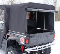 A Rhino camper top bed cover will keep you dry and keep your hunting equipment out of the harsh winter weather on your next hunting trip.  The back rolls up for easy access and it has nice rear tinted windows for backing up. $351.45 http://www.sidebysidestuff.com/camper-top-bed-cover---rhino