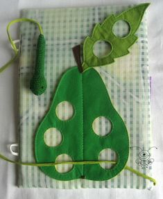 quiet book page: felt caterpillar eating fruit page! could combine this idea with the inchworm page idea in another pin