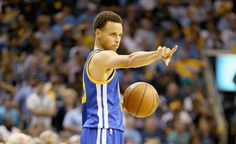 Description of . Stephen Curry #30 of the Golden State Warriors gives instructions to his team against the Memphis Grizzlies during Game 4 of the Western Conference Semifinals of the 2015 NBA Playoffs at FedExForum on May 11, 2015, in Memphis, Tenn.   (Photo by Andy Lyons/Getty Images)