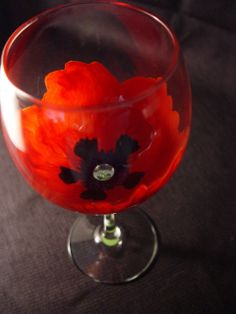 This Red Poppy wine glass is now available in a fine quality, thin walled tasting glass.  The vibrant reds are a feast for the eyes.  Available on Etsy.com at BloominStemware.