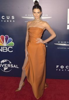 Kendall Jenner wore an orange dress with a thigh-high slit showing off her entire leg at the Universal, NBC, Focus Features, E! Entertainment 2017 Golden Globes after party in Beverly Hills on January 8, 2016