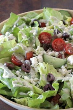 Our Mediterranean salad recipe with yogurt dressing is a great accompaniment to any main course—more so if you're headed to a gathering! Kalamata olives, Greek feta cheese and a light Greek yogurt dressing (made with olive oil) served on bed of sweet butter lettuce—we're talking a winner here!