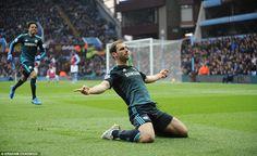 Chelsea defender Branislav Ivanovic runs over the the corner and slides on his knees in celebration after restoring the Blues' lead