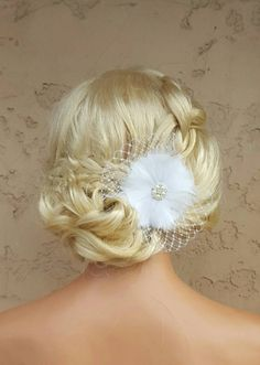 Check out this item in my Etsy shop https://www.etsy.com/listing/262121330/wedding-fascinator-bridal-feather-hair