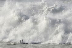 A surfer falls while taking part in the Arnette Punta Galea Big Wave World Tour, on January 28, 2013 in the Northern Spanish Basque town of Getxo. 16 surfers took part during the five hours surf competition, riding 5 meters high waves. AFP PHOTO/ RAFA RIVAS
