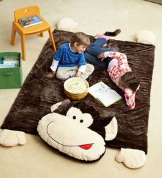 Kids would love to sit on this soft monkey rug. Perfect for a play area.