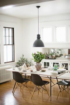 black and white dining room with plants for accent color