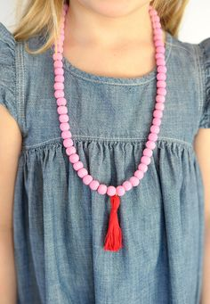 Make this cute wooden bead tassel necklace for Valentine's Day // aliceandlois.com