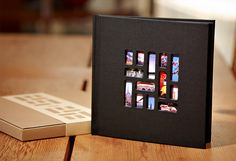 Mosaic Photo Book: $20. Use the app to upload photos and order from your phone