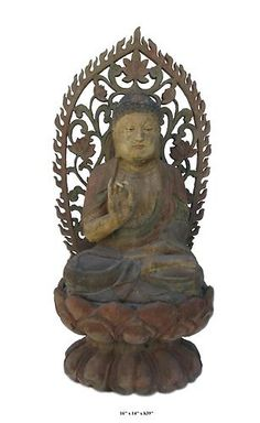 Sakyamuni is the founder of Buddhism. This antique Buddha statue is made of solid elm wood and carved in a round with detailed graphic.  He is sitting on a lotus stand and in a meditation position.    This is a nice prayer's item and also collectable.