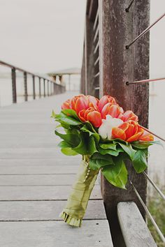 I love that this bouquet of orange tulips included a sentimental note. A single white rose was included in the bunch to honor her father who passed away.