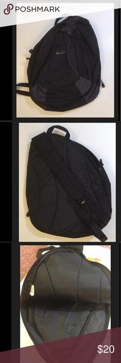 """NIKE SLING BAG SINGLE SHOULDER STRAP BACKPACK USED 100% polyester. Two compartments. One large, padded. Will hold tablets or use it for the gym, the beach or any other casual day when you need to carry lots of things. Front compartment has two inner pockets. Back is comfortable and strap is padded for comfort and ease of carry. Strap is adjustable. 19.5"""" x 15.5"""" approximate measurements. Bag expands to hold quite a lot. It is black and has the distinct NIKE swoosh. Some wear over strap. See…"""