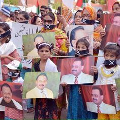 Hyderabad (Pakistan): Children and women symbolically put tapes on their mouth protesting against PEMRA decision that ban Television Channels in Pakistan to air MQM Founder Altaf Hussain's speeches and Interviews.