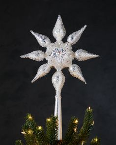 Silvery Star Christmas Tree Topper at Neiman Marcus.