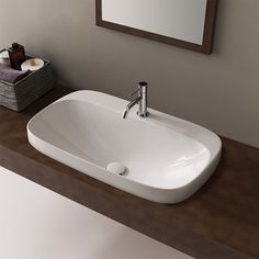 Modern style round white ceramic self-rimming bathroom sink. Sink available in one hole. Sink is made of high-quality ceramic in a white finish. Perfect for modern bathooms. Made in Italy by Scarabeo. Round ceramic sink. Made of high-quality ceramic. Drop in sink application. Sink available in one hole. From the Scarabeo Moon collection. Standard drain size. Drop In Bathroom Sinks, Wall Mounted Bathroom Sinks, Drop In Sink, Small Bathroom, Ceramic Undermount Sink, Ceramic Sink, Modern Ceramics, White Ceramics, Console Sink