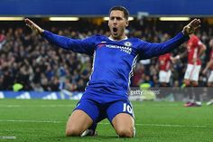 Chelsea's Belgian midfielder Eden Hazard celebrates after scoring their third goal during the English Premier League football match between Chelsea and Manchester United at Stamford Bridge in London on October 23, 2016. / AFP / Glyn KIRK / RESTRICTED TO EDITORIAL USE. No use with unauthorized audio, video, data, fixture lists, club/league logos or 'live' services. Online in-match use limited to 75 images, no video emulation. No use in betting, games or single club/league/player…