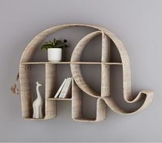 According to folklore, an elephant with raised trunk brings good luck to the home. Made of white-wash rattan wicker, this Woven Elephant Shelf adds charm to your little one's room and has lots of unique spaces to store and display your littl… Deco Elephant, Elephant Home Decor, Elephant Art, Baby Elephant, Elephant Stuff, Elephant Room Ideas, Elephant Decorations, Elephant Quotes, Dream Decor