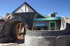 Earth Ship! (completely self sustained home, no air conditioning or heating needed!) --The glass in the walls is piled wine bottles.