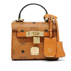 MCM Heritage Satchel (5,315 CNY) ❤ liked on Polyvore featuring bags, handbags, mcm purse, structured purse, structured satchel, satchel purses and monogrammed handbags
