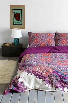 http://www.urbanoutfitters.com/urban/catalog/productdetail.jsp?id=29115847&color=051#/ Urban Outfitters Magical Thinking Medallion Duvet Cover $89 Color: Dark Purple Size: Full/Queen