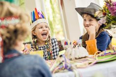 Boys and girls laughing at kids birthday party