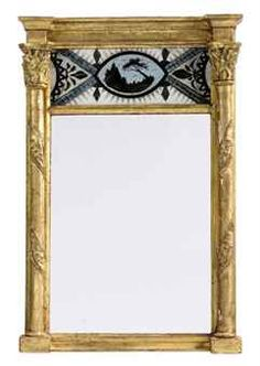 A SMALL GILTWOOD VERRE EGLOMISE MIRROR EARLY 19TH CENTURY