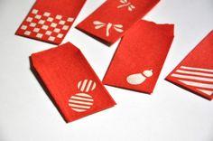 鮮やかな色の手漉き和紙をで和柄の切り絵を使ったミニぽち袋です。500円玉を入れるサイズです。ご縁とご円を合わせて500円玉をお渡ししたり、お守りとして5円玉を入れ身につける事も。