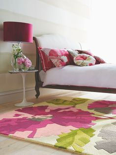 Hermosa features a flamboyant oversized floral motif in warm tones.