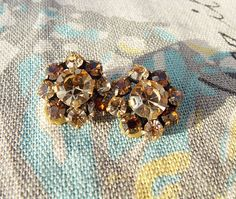 Vintage Star Flower brown, orange clip on earrings by TinksVintageTreasure on Etsy