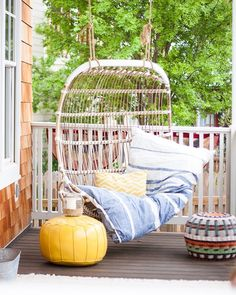 www.instagram.com/pencilshavings  Breezy porch swing in rattan by Serena & Lily - lake house front porch with eclectic mix of textures and patterns. Hedgehouse throwbed.