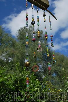 Wind chime made of leftover glass beads, rusty metal and wood by Claudia Burkhardt