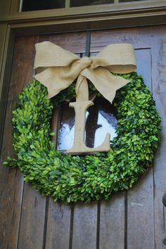 Boxwood wreath with burlap bow and burlap letter Approximately 22-24 inches in diameter Please message me with any questions