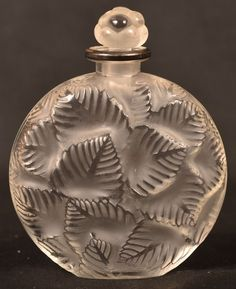 Lalique Ormeaux Frosted Perfume Bottle. : Lot 139