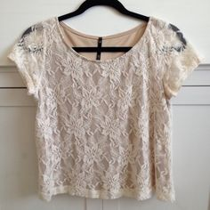 Laced Top Has been worn.  It is in excellent condition. Looks beautiful on. Tops