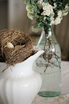Nest on a white pitcher.  Simple, yet so lovely.