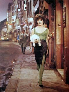 Shirley MacLaine in Irma la Douce, 1963 vintage fashion style 60s Parisianne looks tango skirt black side slit