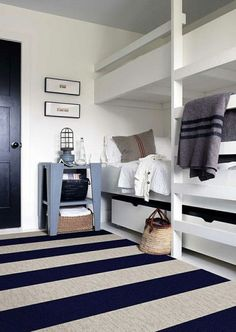 Coastal bedroom with a blue and white stripe rug