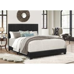 A contemporary look with shades of stately sophistication, this eye-catching panel bed brings a bit of understated elegance and clean-lined appeal to your master suite or guest room. Set it against a taupe-toned wall in the living room to complement its neutral-toned polyester upholstery, then top off nearby nightstands and chests with chrome-finished metal table lamps to match the headboard's trendy nailhead trim. Top it off with a color-block or boldly striped comforter in taupe and mut...