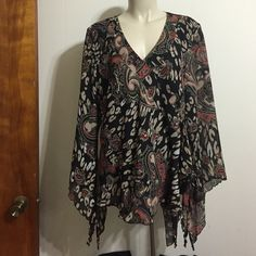 Black, orange, and tan paisley blouse Black, orange, and tan paisley blouse with extra material on the left side to add personality. Surplice front cut and flowing sleeves with slits.  14/16W shell & lining: 100% polyester Cato Tops Blouses