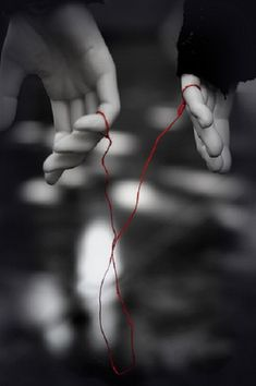 Red thread of fate that binds two souls that were destined to meet...may get tangled or stretched, but never broken.  According to this legend, the gods tie an invisible red string around the little fingers of those who are destined to be together.  The two people connected by the red thread are destined lovers, regardless of time, place or circumstance.