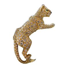Cartier Panther yellow gold ring set with diamonds.