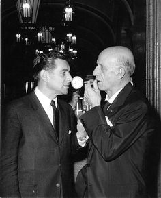 Conductors Leonard Bernstein and Dmitri Mitropoulos. For awhile they were gay lovers.