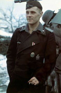 Original photo states this is a member of the Panzer Division during What appears to be a sporting badge and the Panzer Assault badge are displayed. His undershirt's collar is open and rests above his jacket. Ww2 Uniforms, German Uniforms, Military Photos, Military Men, Luftwaffe, Cute Country Boys, Division, Germany Ww2, Ww2 Photos
