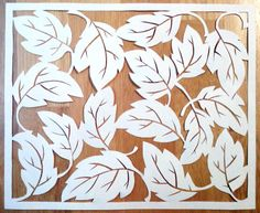 Random Leaves ~cut paper design Random Leaves- designer Paula G.-Cut paper art with leaves. Ivory paper, width 8.5 in...© copyright PaulaGGG All Rights Reserved - contact stencilletta@gmail.com
