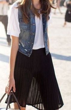 Knee-length black silk skirt, loose white tee & jean vest. (35)