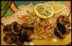 Tilapia Al Ajillo (Garlic Tilapia) from Food.com:   								You can do this with any white fish, sea bass is great this way. Fish is often served this way in the Canary Islands, though usually it is the whole fish instead of fillets. YUM!
